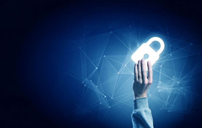 Hand holding a lock. The lock is glowing and there is a blue background